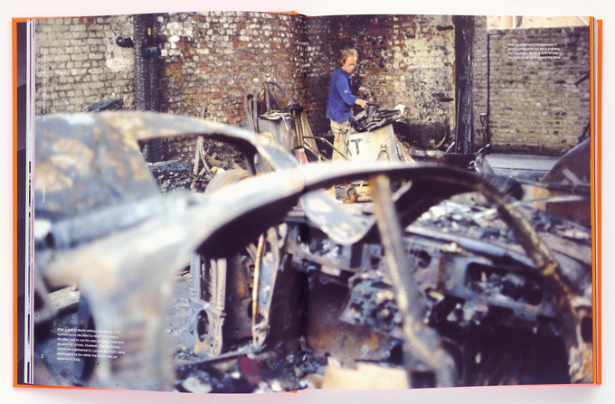 Spiekermann clearing up his workshop after the fire