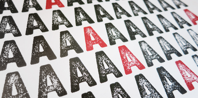 Martinson prints off sheets of variations of each letter to choose different texture levels for each letter.